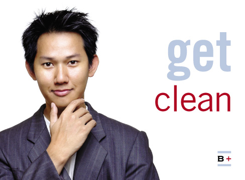 an east Asian man in a suit with his hand to his smooth-shaven chin, captioned 'get clean'