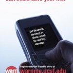 a poster showing a hand holding a cell phone. The poster says 'Sign up for the warning that could save your life.'